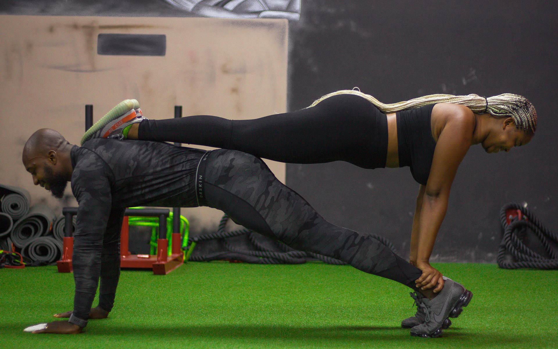 Two people adding balance training to their press up workout to work on proprioception